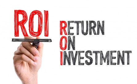 Hand with marker writing the word ROI - Return on Investment