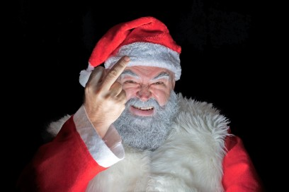 Angry Santa Claus showing the middle finger