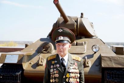 Defender of Stalingrad veteran of World War II colonel Vladimir Semenovich Turov at the T-34 tank